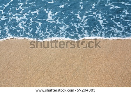 Golden sand and blue sea - stock photo
