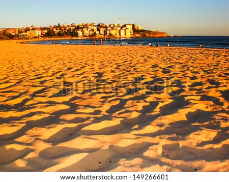 golden sand at Bondi beach ,Sydney in late afternoon. - stock photo