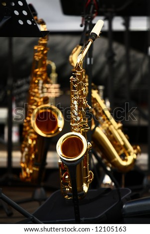 golden saxophones on stage - stock photo
