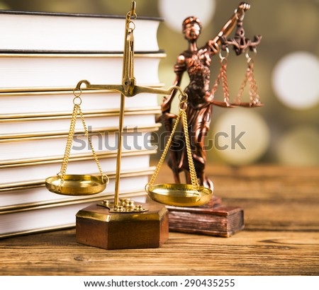 Golden scales of justice, books, Statue of Lady Justice. - stock photo