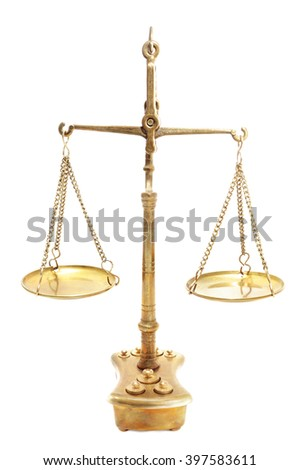 Golden scales of justice in close-up isolated on white background - stock photo