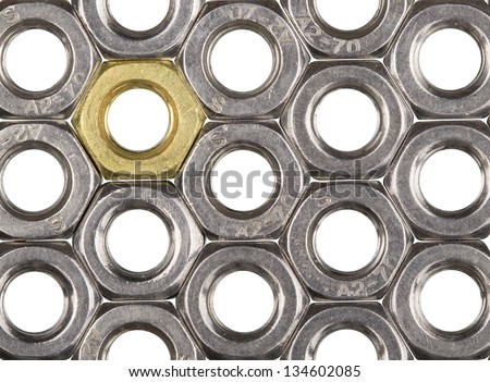 Golden screw nut in steel nuts pattern isolated on white - stock photo