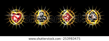 Golden shiny card suits isolated on black background. - stock photo