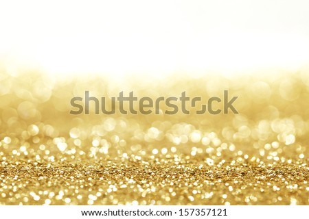 Golden shiny glitter holiday celebration background with white copy space - stock photo