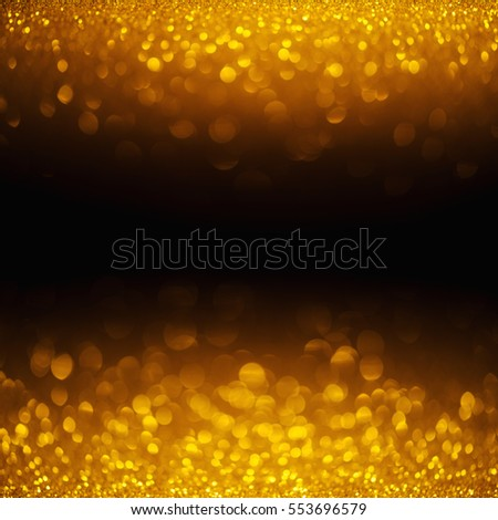 Golden shiny glitter lights horizontal bokeh background with copy-space