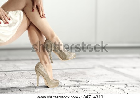 golden shoes of woman and free space  - stock photo