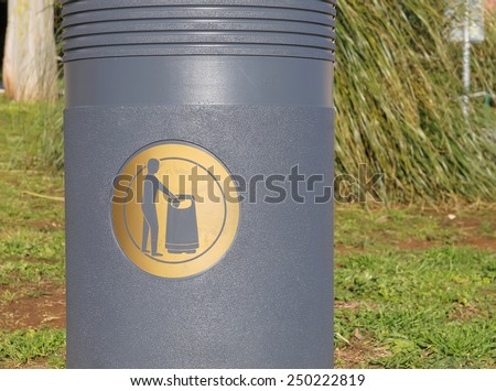 golden sign label on grey trash basket       - stock photo