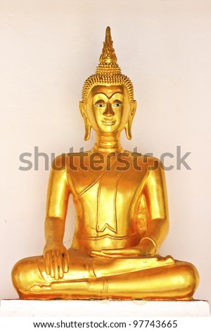 Golden sitting Buddha statue in temple in thailand