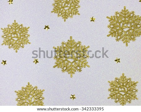 Golden snow flakes with glittering white background. Christmas theme - stock photo