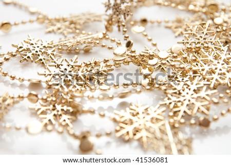 golden snowflakes isolatad on white - stock photo