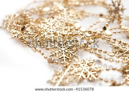 golden snowflakes isolated on white - stock photo