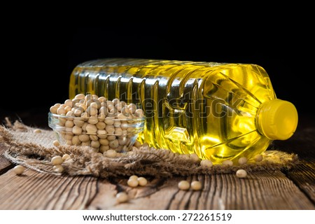 Golden Soy Oil on dark wooden background (close-up shot) - stock photo