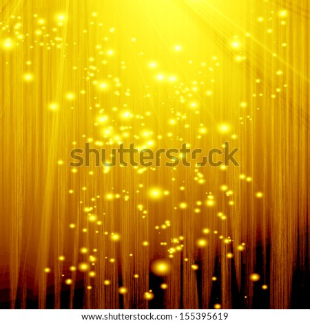 golden spotlight with some glitter and sparkles on it - stock photo
