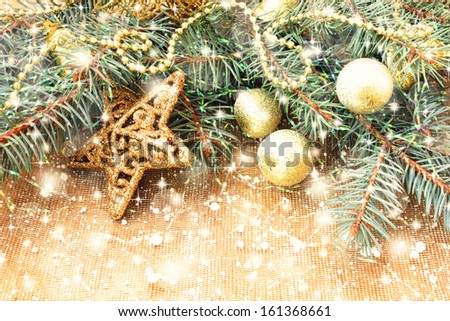 golden star and other christmas decorations on a shiny background - stock photo