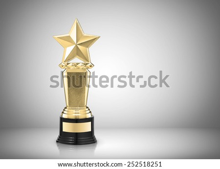 Golden star award on gray background - stock photo
