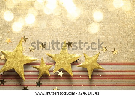 Golden star on paper textured background - stock photo
