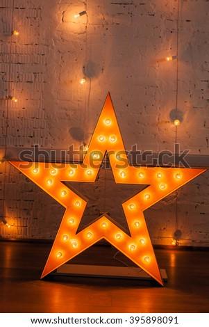 golden star with bulbs - stock photo