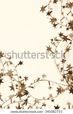 Golden stars and spangles can use as holiday background. In Sepia toned. Retro style