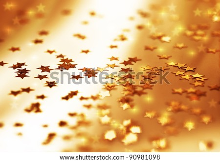Golden stars background, beautiful shiny abstract starry backdrop, decorative ornamental pattern, Christmas eve winter holiday design, shallow depth of field - stock photo