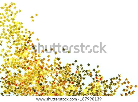 Golden stars in the form of confetti on white - stock photo