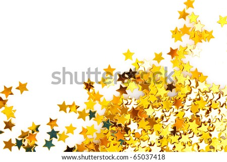 Golden stars in the form of confetti on white background - stock photo