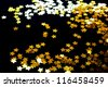 Golden stars on a black background - stock photo