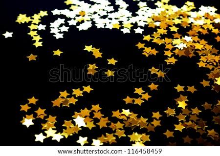 Golden stars on a black background - stock photo