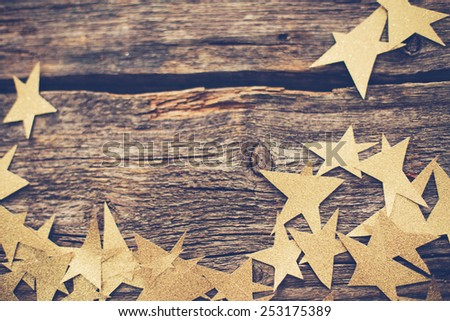 Golden stars on the wooden floor