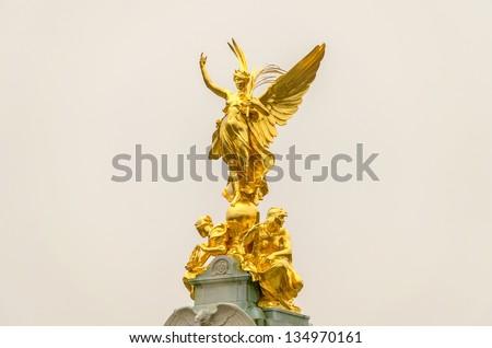 Golden Statue at Buckingham Palace, London, UK - stock photo