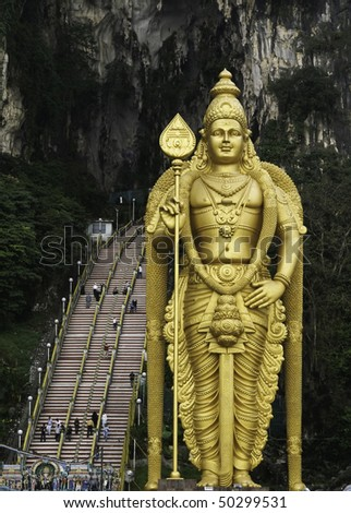 Golden statue in front of Batu Caves in Kuala Lumpur, Malaysia - stock photo