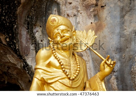 Golden statue of a Chinese god at the Tiger Cave Temple (Wat Tham Seua) in Krabi, Thailand - stock photo