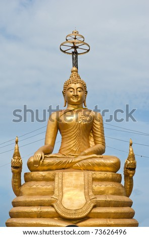 Golden statue of Buddha on the hill in Phuket island, Thailand - stock photo