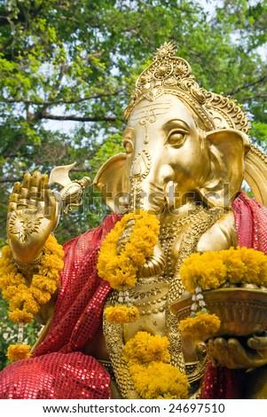 Golden statue of Ganesha - the Elephant headed god of luck and prosperity - stock photo