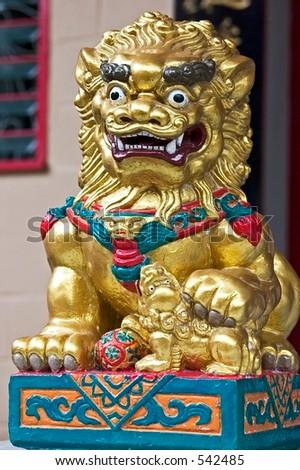 Golden Stone Lion - stock photo