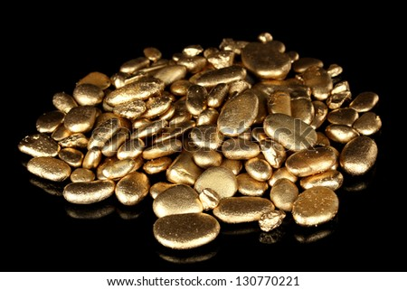 Golden stones isolated on black