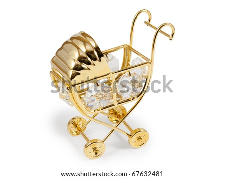 Golden stroller with crystals. Isolated on white background with clipping path. - stock photo