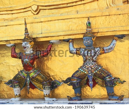 Golden stupa and its guards - stock photo