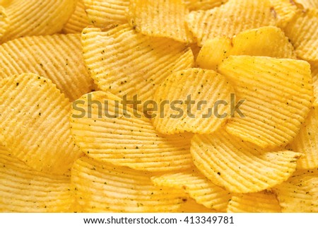 Golden subfried potato slices with onions pieces.