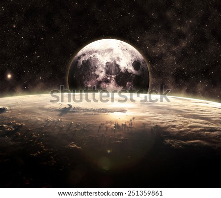 Golden Sunrise and the Moon - Elements of this Image Furnished by NASA - stock photo