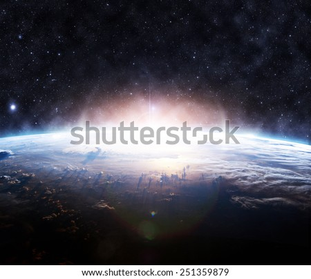 Golden Sunrise - Elements of this Image Furnished by NASA - stock photo