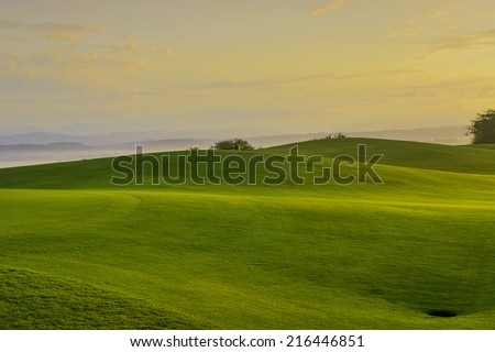Golden sunrise on golf greens, Philippines