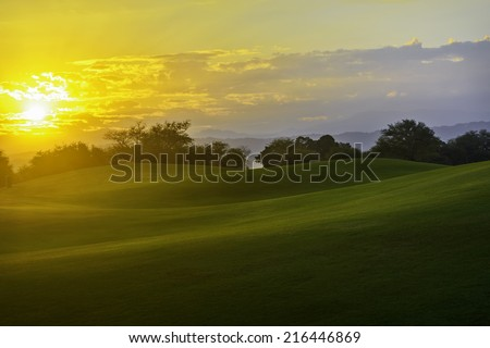 Golden sunrise on golf greens, Philippines - stock photo