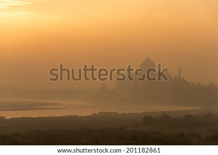 Golden sunrise over Taj Mahal and Yamuna river in Agra, India