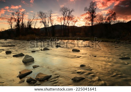 Golden sunset along the Provo River, Utah, USA. - stock photo