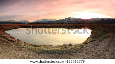Golden sunset at a farm pond, Utah, USA. - stock photo