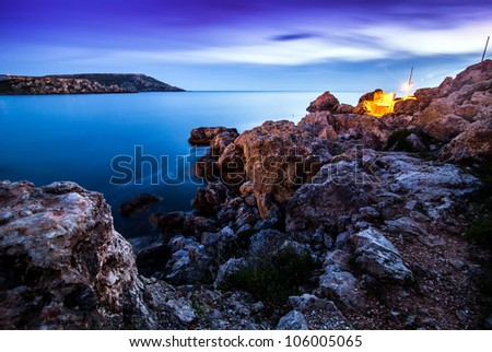 Golden Sunset at golden bay on Malta - stock photo