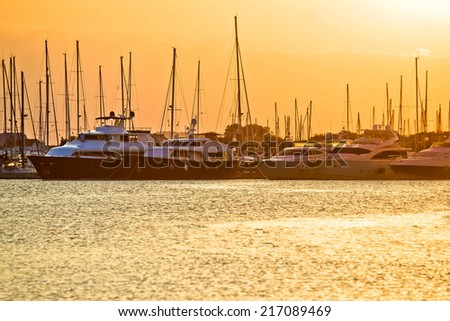 Golden sunset at yacht club, Sukosan, Croatia - stock photo