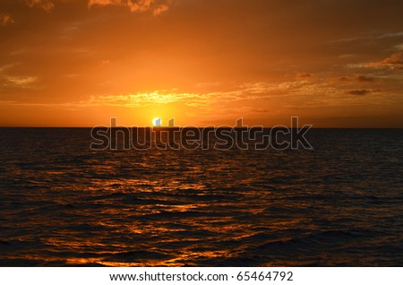 Golden Sunset Landscape Over Pacific Ocean Waters - stock photo