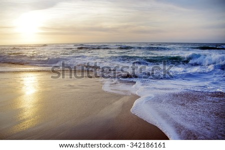 golden sunset on the sea at portuguese coast - stock photo