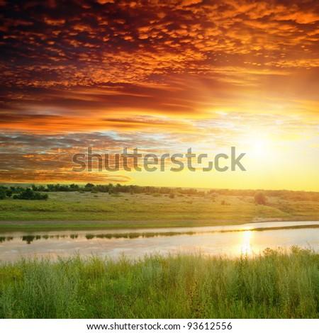 golden sunset over river - stock photo